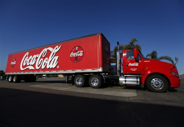 A Coca-Cola truck fills up with diesel fuel at a gas station in Carlsbad California