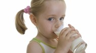 Little girl drinking milk
