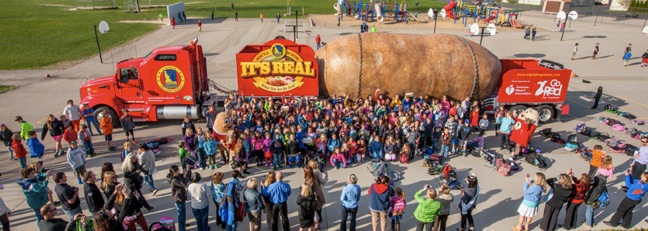 Hundreds of Riverside Elementary School students in Boise, Idaho, along with teachers, parents and the Idaho Potato Commission's mascots Spuddy Buddy and Spud Beauty, gave the truck a big and loud send off.