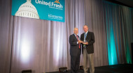 United Fresh Produce Association president and CEO Tom Stenzel presented the award to David Krause, president of Paramount Citrus.