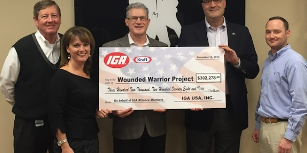 Wounded Warrior Project's Tim Crosby, left, and Max Van Arsdale, right, accept the donation from IGA's Heidi Huff, Dave Bennett and Wayne Altschul (not pictured is Kraft's Mike Ridenour).