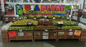 Dan Atkinson of Hy-Vee was last year's pear display contest winner (10 registers or more).