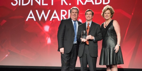 Dave Dillon accepts the Sidney R. Rabb Award from Jerry Garland and Leslie Sarasin.