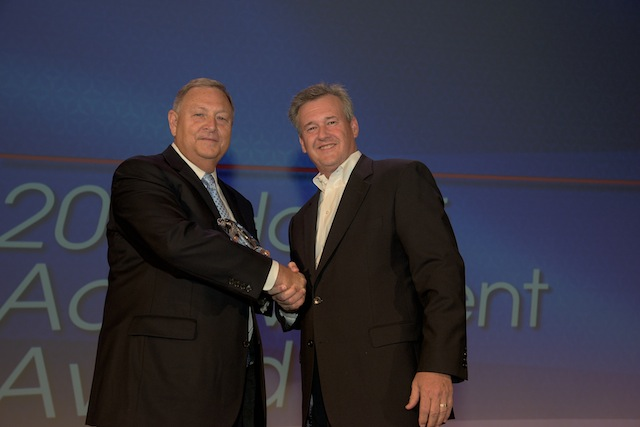 George Deese, chairman of the board of Flowers Foods, left, accepts the GMA Hall of Achievement Award.