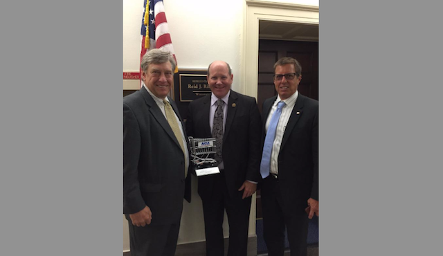 Brandon Scholz, president and CEO, Wisconsin Grocers Association; Congressman Reid Ribble; and Brian Horrigan, director of business development, IGA Inc.