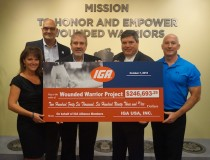 IGA team members Heidi Huff and Wayne Altschul and IGA retail representatives Tony Groszew and John Verrone of Adams Hometown Market IGA present the donation to Wounded Warrior Project EVP Gary Coreless at WWP headquarters in Jacksonville, Florida.
