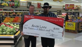 Tim Watts, VP of merchandising, sales and marketing, Shop 'n Save; contest winner Aaron Lane.