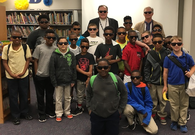 Local school board member Don Muhlbach, Brookshire Brothers President and CEO Jerry Johnson and the students sport Chiquita sunglasses.
