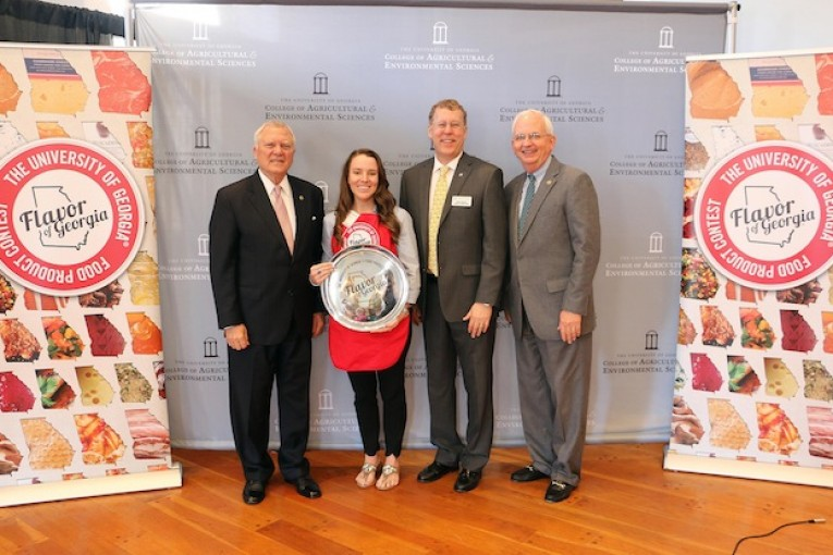 Amanda Wilbanks, owner of Southern Baked Pie Co. in Gainesville, accepts her University of Georgia Flavor of Georgia grand prize trophy from Gov. Nathan Deal; Sam Pardue, dean and director of the UGA College of Agricultural and Environmental Sciences; and Georgia Agriculture Commissioner Gary Black. (Photo courtesy of Merritt Melancon, University of Georgia)