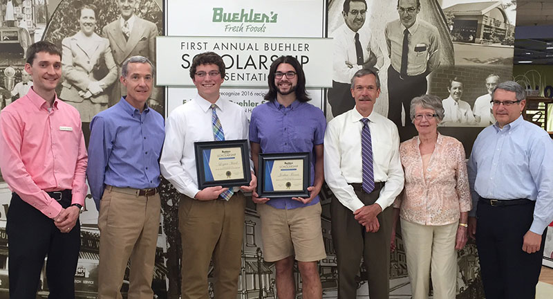 Buehler family members with scholarship winners Logan Haid and Joshua Froats (center).