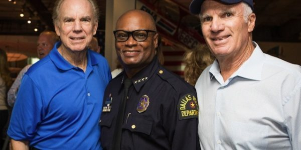 Roger Staubach, former Dallas Cowboys quarterback; Dallas Police Chief David Brown; Southern Glazer Executive Vice Chairman Bennett Glazer.