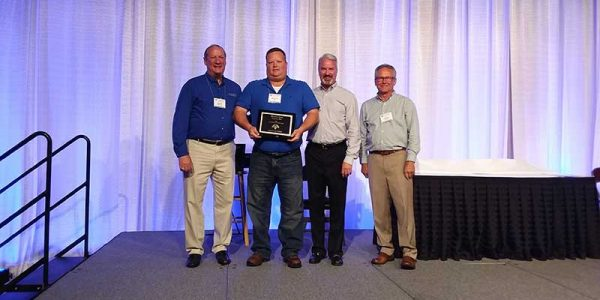 Martin Cox of Cox Foods, which operates 10 stores in Kentucky, receives Laurel Grocery Co.'s Retailer of the Year award.