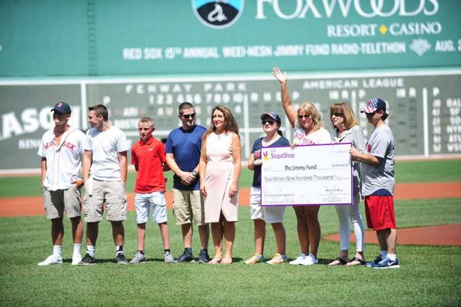 Members of Stop & Shop came together with families and members of The Jimmy Fund and Dana-Farber Cancer Institute for the check donation at Boston's Fenway Park.