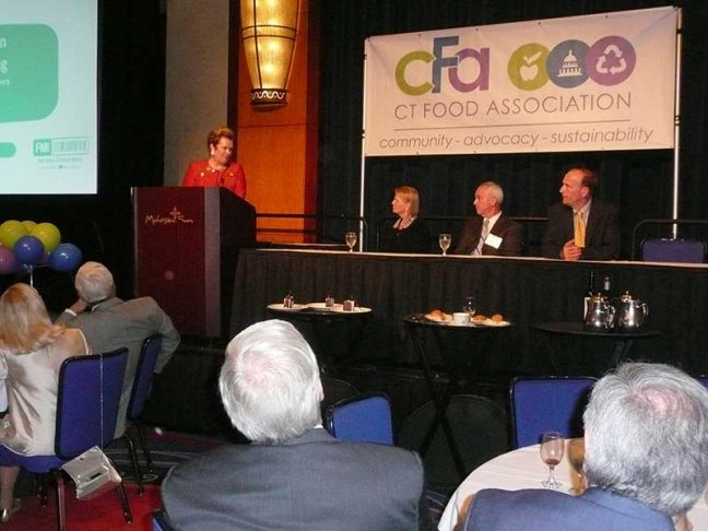 FMI President Leslie Sarasin accepts the CFA Person of the Year Award alongside Elizabeth Chace-Marino of Ahold USA; Michael Gold of Big Y, CFA chairman; and Wayne Pesce, CFA president.