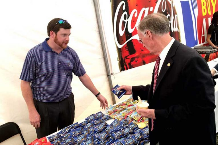 Alabama Gov. Robert Bentley samples some of Birmingham-based Bud's Best Cookies.