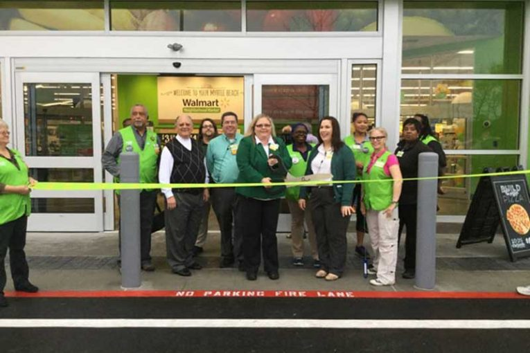 store manager sherrie carlisle cuts the ceremonial ribbon on the new walmart neighborhood market in myrtle
