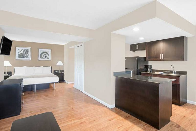 A Hawthorn Suites by Wyndham guest room now features a fully-equipped kitchen.