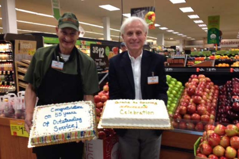 Store Director Jim Burns, right, congratulates employee Mike Mezzadri, who has worked for Shaw's for 55 years.
