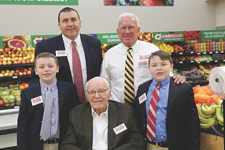 Grandsons J.P. Rowton, left, and William Rowton, right, flank their great-grandfather Oral Edwards; back, from left, Paul Rowton, company VP, with his father-in-law, company president Steve Edwards.