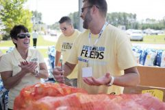 Meg Ham, left, with Food Lion volunteers doing pantry makeovers for food banks as part of Food Lion Feeds.
