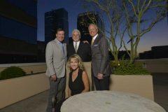 Jack Pelo, president and CEO; Rocky Christeson, COO; Paul Lukanowski, SVP GM; and Cox, all of Swire Coca-Cola.