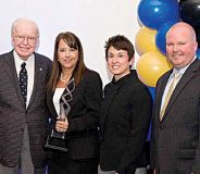 Ralph Ketner with 2014 Store Manager of the Year award winner, Rhonda Mauldin, Food Lion store manager in Simpsonville, South Carolina; Meg Ham, Food Lion president, and Greg Finchum, Food Lion SVP of retail operations.
