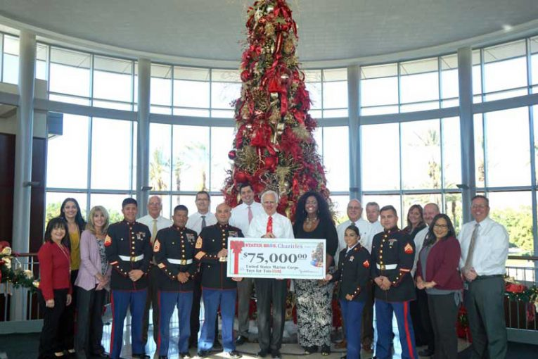 representatives from Stater Bros. gathered to present a $75,000 check to local Toys for Tots Program ambassadors.