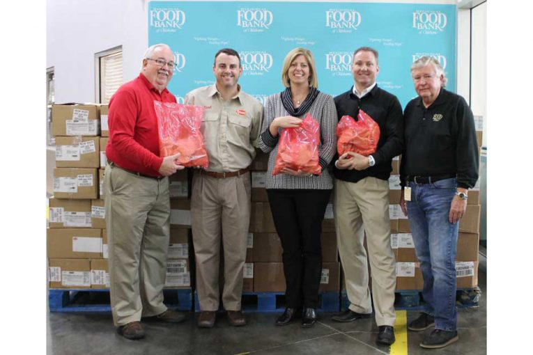 Bill Hendrix, resource development officer, Regional Food Bank; Brad Lynch, customer development manager, Tyson; Katie Fitzgerald, CEO, Regional Food Bank; Brett Lopp, Acosta Sales & Marketing; and Jack Miller, resource development officer, Regional Food Bank.