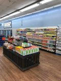 Wood-look product displays and new flooring are part of the Piggly Wiggly Country Fresh remodel.