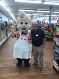 Tommy Coogle with Mr. Pig, Piggly Wiggly's beloved mascot.