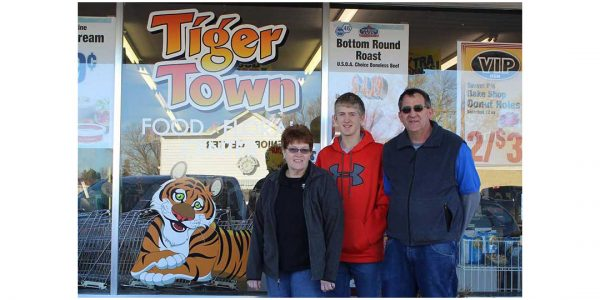 Nancy, Jared and James Bessmer in front of Tiger Town Food & Floral Center prior to the fire.