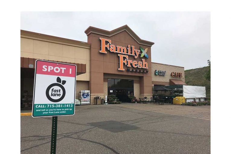 A Family Fresh Market with Fast Lane signage