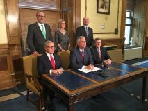 Gov. Eric Holcomb signs Senate Bill 1 into law on Feb. 28 to legalize Sunday sales in Indiana. Seated, from left, Sen. Ron Alting; Gov. Holcomb; Rep. Ben Smaltz; standing, from left, Senate President David Long, Lt. Gov. Suzanne Crouch and House Speaker Brian Bosma. All are Republicans.
