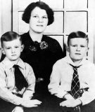 Mrs. Louise Brookshire, wife of founder Wood T. Brookshire, with sons Woody and Bruce.