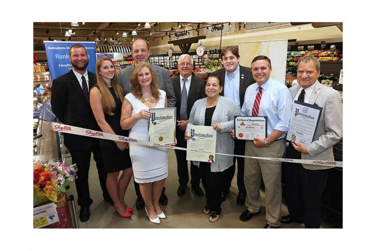 Local leaders join the Gallagher family for a ribbon-cutting ceremony Aug. 3 at the new ShopRite of Lake Ronkonkoma.