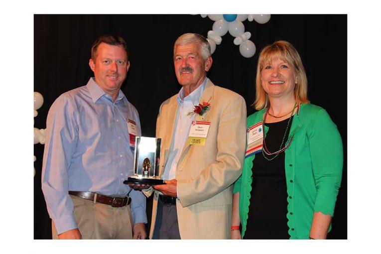 MGA Board Chairman Mark Collier; Dean Simpson; MGA President Jamie Pfuhl.