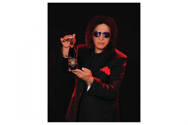 Gene Simmons holding a Money Bag soda bottle