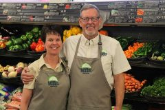 Sherri and Mitch Bradley, owners of Heeb's East Main Grocery in Bozeman, Montana, sport their shirts featuring the logo they will employ at their new store.