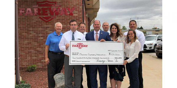 Fareway representatives present a check from the golf tournament.