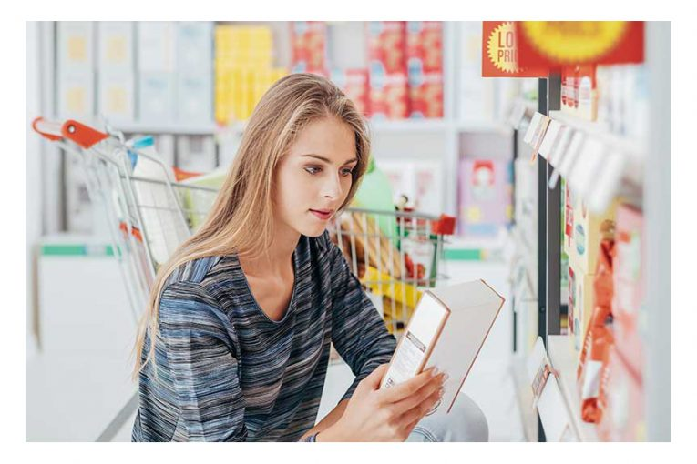 A woman reading a product label