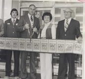 "In 1974, the Nilsson family cuts the ""ribbon"" to open the Windsor, Connecticut, store. Pictured are Jim Nilsson Jr., Jim Nilsson Sr., Mary Geissler Nilsson and A.F. Geissler."