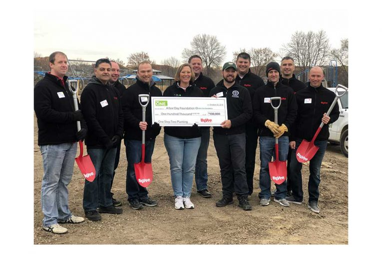 Hy-Vee representatives presented a check to the Arbor Day Foundation.