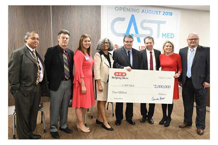H-E-B representatives present a $2 million check for CAST Med High School.