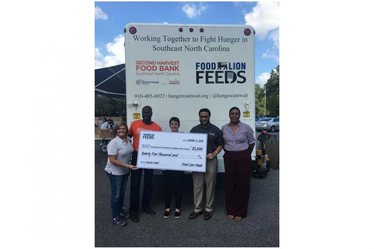 Food Lion presents a check for Florence disaster relief.