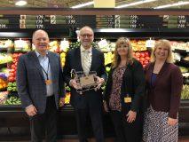 Tom Clasen, VP of operations, Knowlan's Super Markets Inc.; Sen. Roger Chamberlain; Robin Mishler, Festival Foods store manager; Pfuhl.