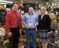 Kyle Wensmann, Coborn's store manager; Rep. Ron Kresha; and Pfuhl.