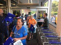 Food Lion staff greet opening-day visitors at a refreshed Norfolk-area store.